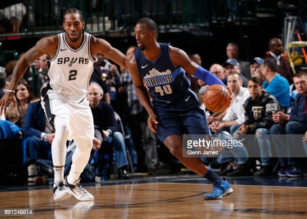 Harrison Barnes of the Dallas Mavericks handles the ball against Kawhi Leonard of the San Antonio Spurs on December 12 2017 at the American Airlines...