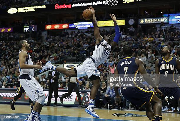 Harrison Barnes of the Dallas Mavericks is fouled by CJ Miles of the Indiana Pacers in the second half at American Airlines Center on December 9 2016...