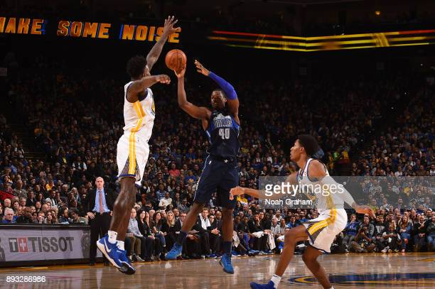 Harrison Barnes of the Dallas Mavericks looks to pass against the Golden State Warriors on December 14 2017 at ORACLE Arena in Oakland California...
