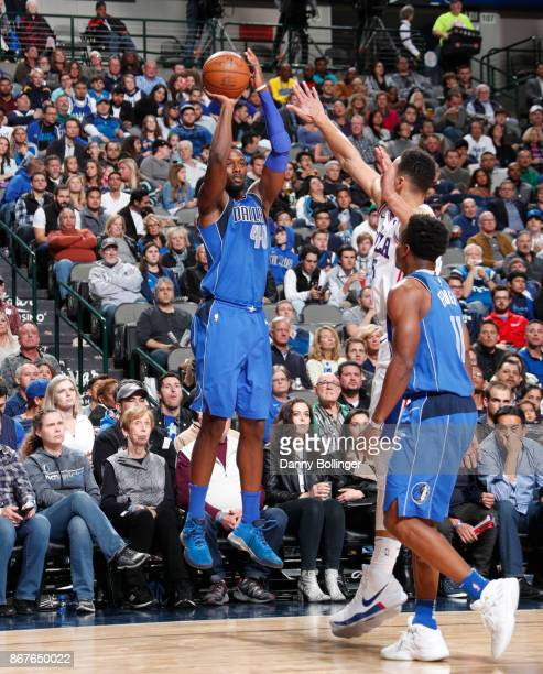 Harrison Barnes of the Dallas Mavericks shoots the ball against the Philadelphia 76ers on October 28 2017 at the American Airlines Center in Dallas...