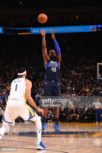 Harrison Barnes of the Dallas Mavericks shoots the ball against the Golden State Warriors on December 14 2017 at ORACLE Arena in Oakland California...