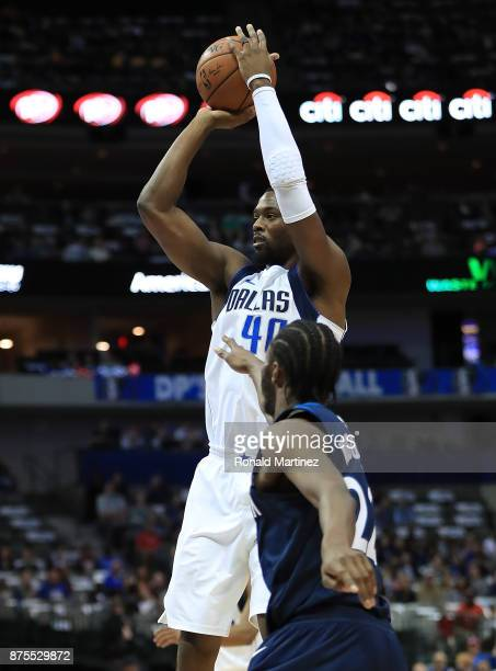 Harrison Barnes of the Dallas Mavericks takes a shot against Andrew Wiggins of the Minnesota Timberwolves at American Airlines Center on November 17...