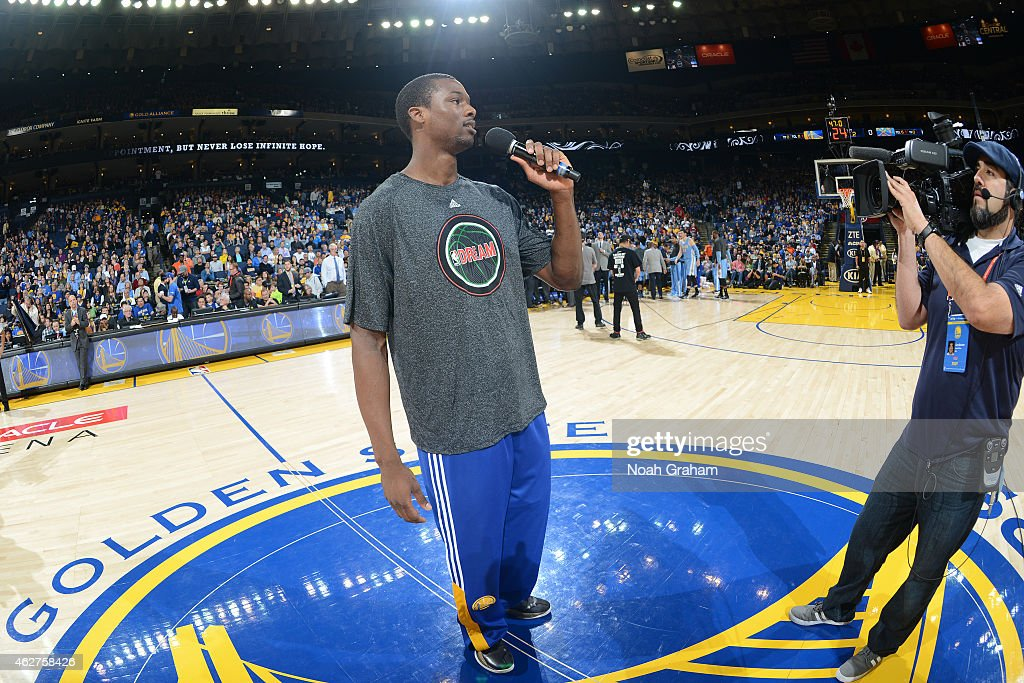 Harrison Barnes #40 of the Golden State Warriors addresses the crowd before a game against the Denver Nuggets on January 19, 2015 at Oracle Arena in Oakland, California.