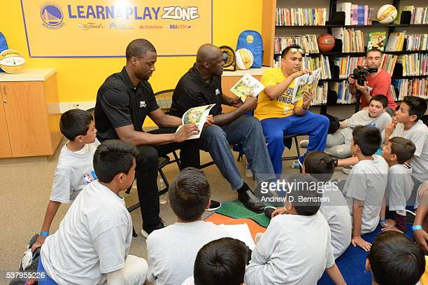 Harrison Barnes of the Golden State Warriors and former player Adonal Foyle read a book to the children at the 2016 NBA Finals Cares Legacy project...