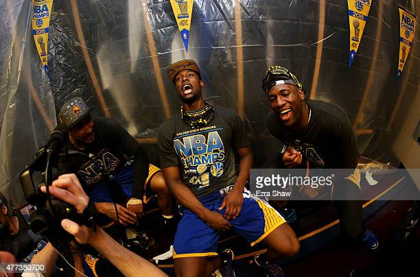 Harrison Barnes of the Golden State Warriors and teammates celebrate in the locker room after they defeated the Cleveland Cavaliers 105 to 97 in Game...