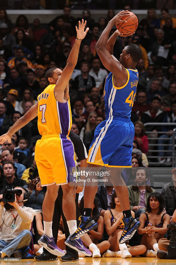 Harrison Barnes #40 of the Golden State Warriors attempts a shot against Xavier Henry #7 of the Los Angeles Lakers on November 22, 2013 at STAPLES Center in Los Angeles, California.