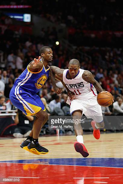 Harrison Barnes of the Golden State Warriors defends against Jamal Crawford of the Los Angeles Clippers during a game at Staples Center on November...