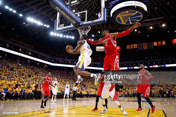 Harrison Barnes of the Golden State Warriors drives to the basket against Dwight Howard of the Houston Rockets in the second half during game two of...