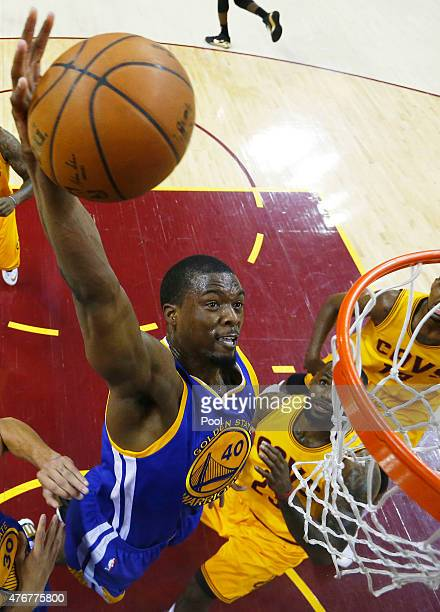Harrison Barnes of the Golden State Warriors dunks against LeBron James of the Cleveland Cavaliers in the first half during Game Four of the 2015 NBA...