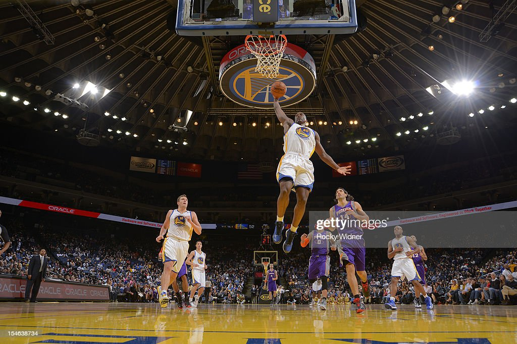Harrison Barnes #40 of the Golden State Warriors dunks the ball against the Phoenix Suns during a pre-season game on October 23, 2012 at Oracle Arena in Oakland, California.