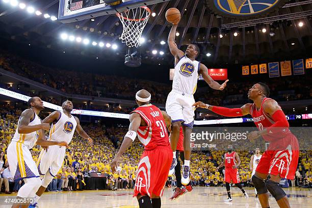 Harrison Barnes of the Golden State Warriors dunks the ball in the fourth quarter against the Houston Rockets during game five of the Western...