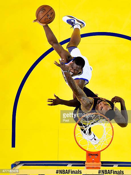 Harrison Barnes of the Golden State Warriors goes up against JR Smith of the Cleveland Cavaliers in the first half during Game Five of the 2015 NBA...