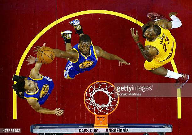 Harrison Barnes of the Golden State Warriors goes up against LeBron James of the Cleveland Cavaliers in the first half during Game Four of the 2015...
