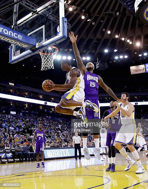Harrison Barnes of the Golden State Warriors goes up for a shot on DeMarcus Cousins of the Sacramento Kings at ORACLE Arena on January 23, 2015 in...