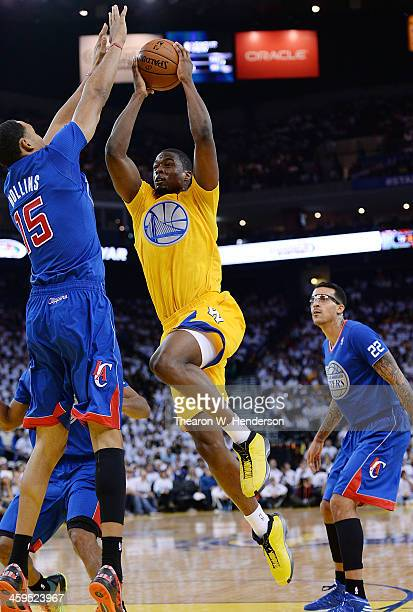 Harrison Barnes of the Golden State Warriors goes up to shoot over Ryan Hollins of the Los Angeles Clippers at ORACLE Arena on December 25 2013 in...