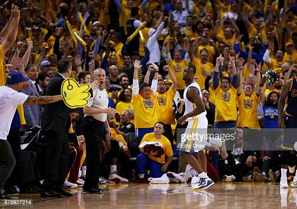 Harrison Barnes of the Golden State Warriors reacts after shooting for three in overtime against the Cleveland Cavaliers during Game One of the 2015...
