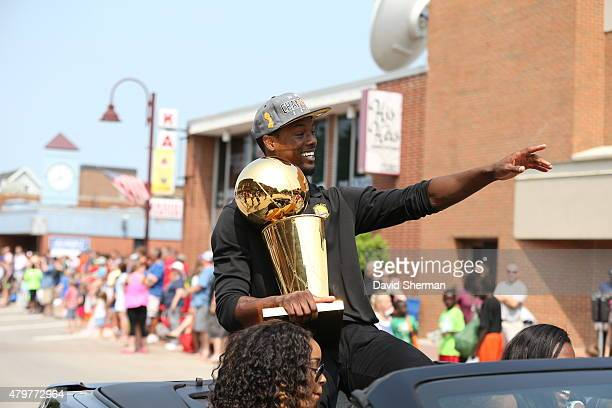 Harrison Barnes of the Golden State Warriors serves as Grand Marshal of the annual 4th of July parade with the Larry O'Brien Championship Trophy on...