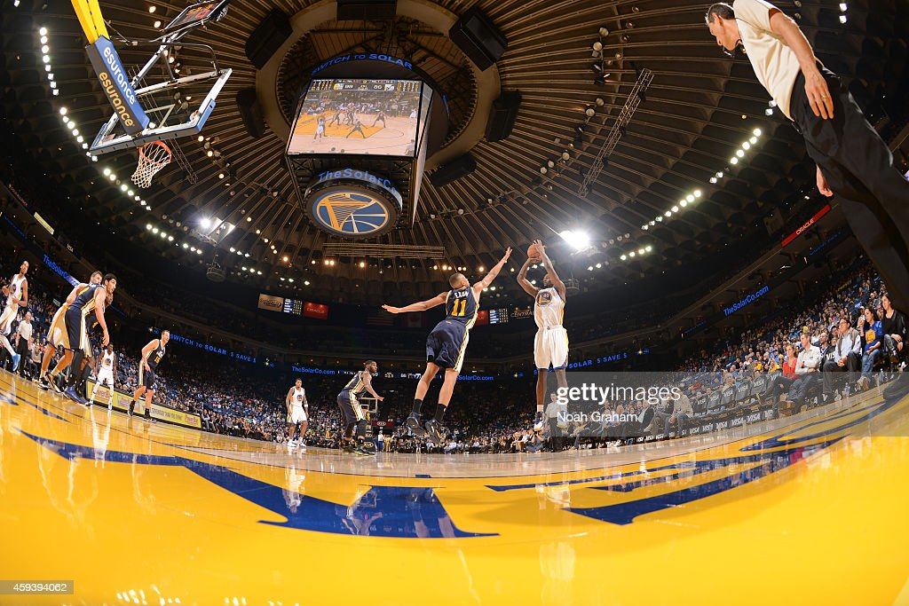 Harrison Barnes #40 of the Golden State Warriors shoots against Dante Exum #11 of the Utah Jazz on November 21, 2014 at Oracle Arena in Oakland, California.