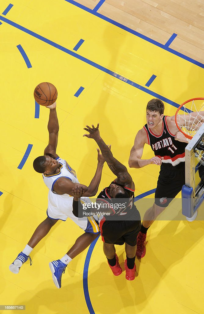 Harrison Barnes #40 of the Golden State Warriors shoots against J.J. Hickson #21 of the Portland Trail Blazers on March 30, 2013 at Oracle Arena in Oakland, California.
