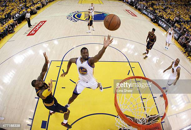 Harrison Barnes of the Golden State Warriors shoots against LeBron James of the Cleveland Cavaliers in the second half during Game Five of the 2015...