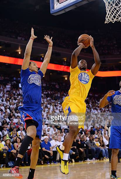 Harrison Barnes of the Golden State Warriors shoots over Ryan Hollins of the Los Angeles Clippers at ORACLE Arena on December 25 2013 in Oakland...