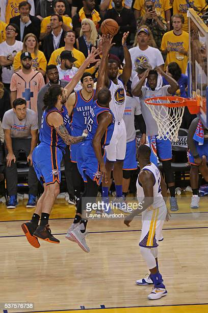 Harrison Barnes of the Golden State Warriors shoots the ball over players from the Oklahoma City Thunder in Game Five of the Western Conference...