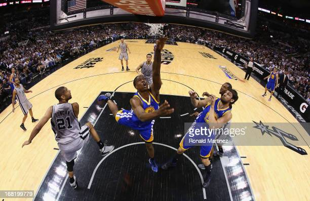 Harrison Barnes of the Golden State Warriors takes a shot against the San Antonio Spurs during Game One of the Western Conference Semifinals of the...