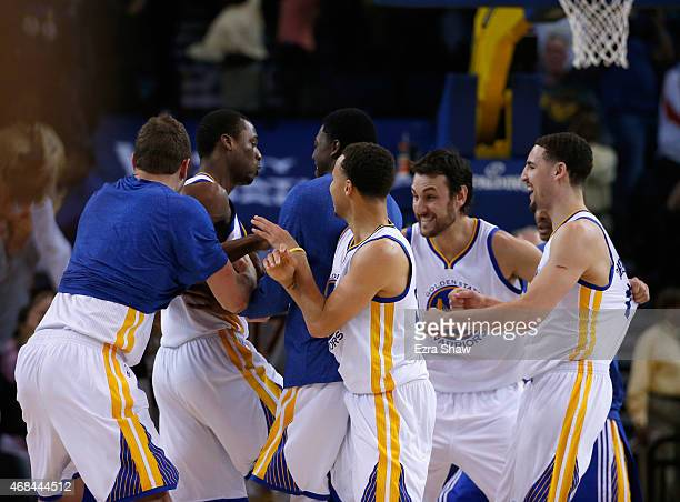 Harrison Barnes of the Golden State Warriors, who made the game-winning shot, is congratualted by teammates after they beat the Phoenix Suns at...