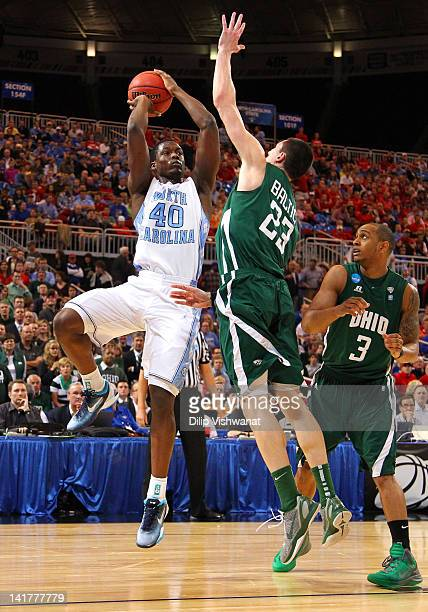 Harrison Barnes of the North Carolina Tar Heels attempts a shot in the first half against Ivo Baltic and Walter Offutt of the Ohio Bobcats during the...