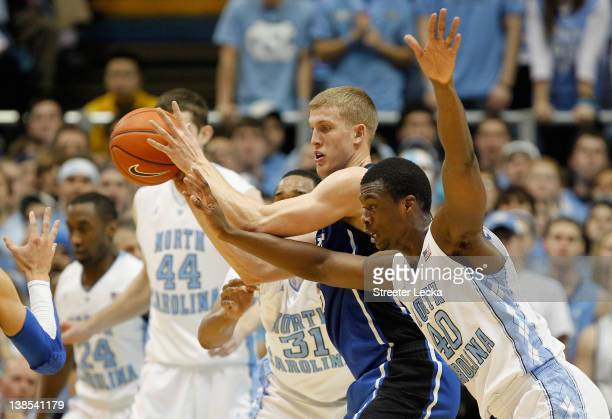 Harrison Barnes of the North Carolina Tar Heels dives for the ball against Mason Plumlee of the Duke Blue Devils during their game at the Dean Smith...