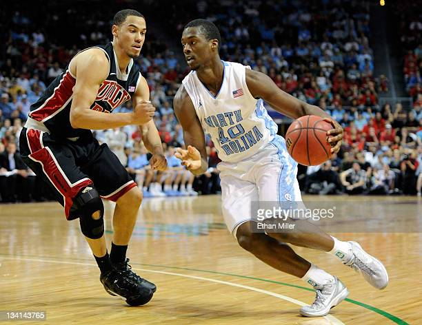 Harrison Barnes of the North Carolina Tar Heels drives against Chace Stanback of the UNLV Rebels during the championship game of the Continental Tire...
