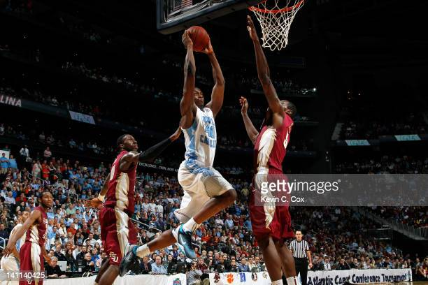 Harrison Barnes of the North Carolina Tar Heels drives for a dunk attempt against Bernard James of the Florida State Seminoles during the Final Game...