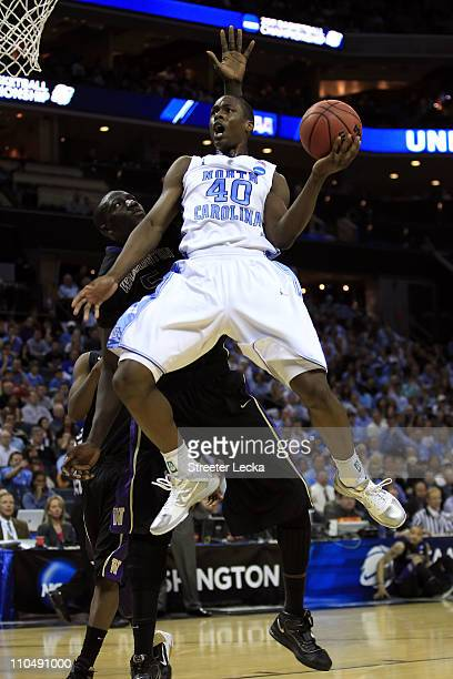 Harrison Barnes of the North Carolina Tar Heels goes up for a shot against Aziz N'Diaye of the Washington Huskies in the first half during the third...