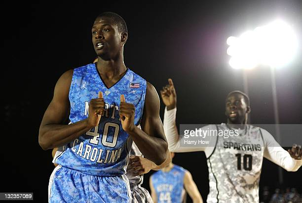 Harrison Barnes of the North Carolina Tar Heels reacts alongside Draymond Green of the Michigan State Spartans in the first half during the NCAA...