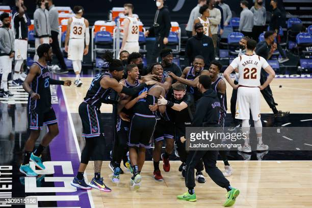 Harrison Barnes of the Sacramento Kings celebrates with teammates after making a three point shot to win the game against the Cleveland Cavaliers at...