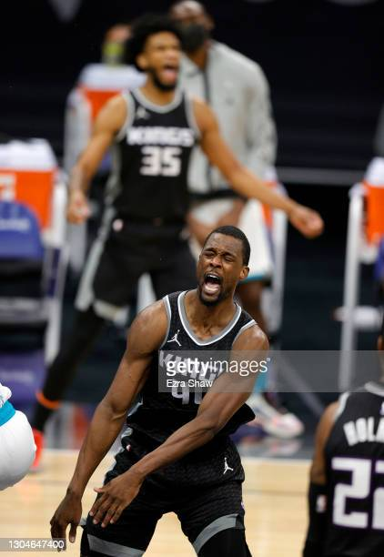 Harrison Barnes of the Sacramento Kings reacts after dunking the ball against the Charlotte Hornets in the fourth quarter at Golden 1 Center on...