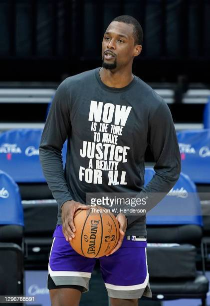 "Harrison Barnes of the Sacramento Kings warming up wears a Nike basketball shooting shirt that displays on the font ""Now Is The Time To Make Justice..."