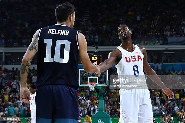 Harrison Barnes of United States shakes hands with Carlos Delfino of Argentina during the Men's Quarterfinal match on Day 12 of the Rio 2016 Olympic...