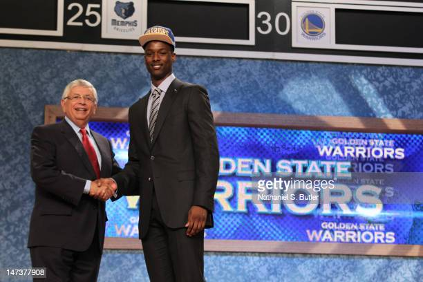 Harrison Barnes shakes hands with NBA Commissioner David Stern after being selected number seven overall by the Golden State Warriors during the 2012...