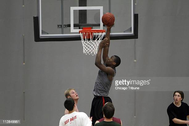 Harrison Barnes the nation's toprated high school basketball recruit lays up a shot during the first day of practice at Ames High School in Ames Iowa...