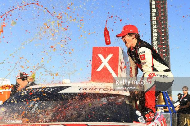 Harrison Burton driver of the Dex Imaging Toyota celebrates in Victory Lane after winning the NASCAR Xfinity Series Production Alliance Group 300 at...
