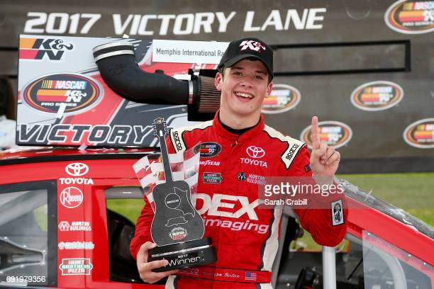 Harrison Burton driver of the DEX Imaging Toyota celebrates in Victory Lane after winning the NASCAR KN Pro Series East Memphis 125 presented by...