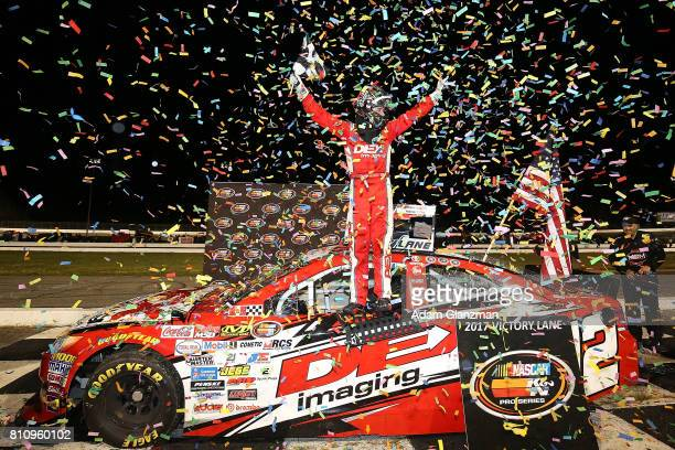 Harrison Burton driver of the DEX Imaging Toyota celebrates in Victory Lane after winning the NASCAR KN Pro Series East at Thompson Speedway...
