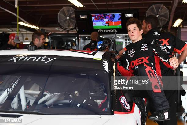 Harrison Burton driver of the Dex Imaging Toyota gets into his car during practice for the NASCAR Gander Outdoor Truck Series MM'S 200 at Iowa...