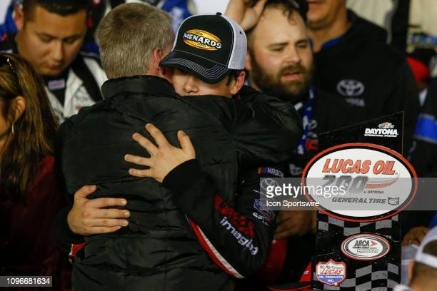 Harrison Burton driver of the DEX Imaging Toyota hugs dad Jeff Burton following the Lucas Oil 200 Driven by General Tire on February 9 2019 at...