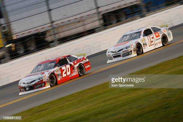 Harrison Burton driver of the DEX Imaging Toyota leads Christian Eckes driver of the Venturini Motorsports Toyota during the Lucas Oil 200 Driven by...
