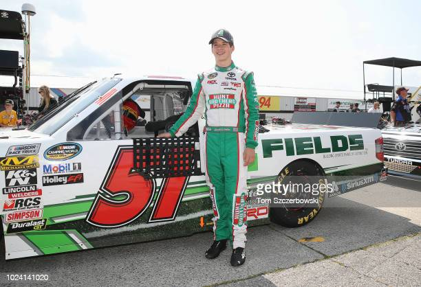 Harrison Burton driver of the Hunt Brothers Pizza/Fields Toyota poses before the start of the 6th Annual Chevrolet Silverado 250 at Canadian Tire...