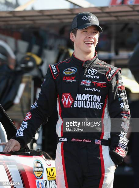 Harrison Burton driver of the Morton Buildings Toyota stands by his truck during practice for the NASCAR Camping World Truck Series MM's 200 at Iowa...