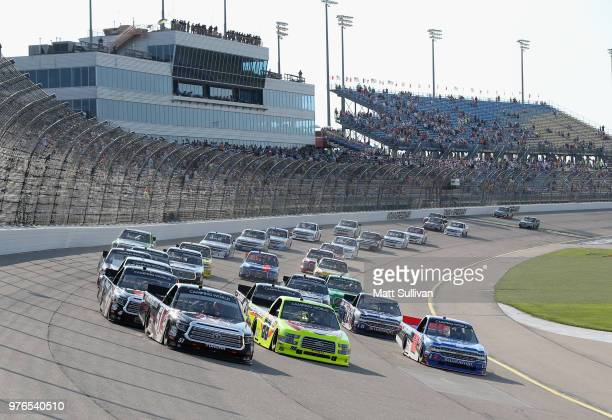 Harrison Burton driver of the Morton Buildings Toyota takes the green flag to start the NASCAR Camping World Truck Series MM's 200 presented by...