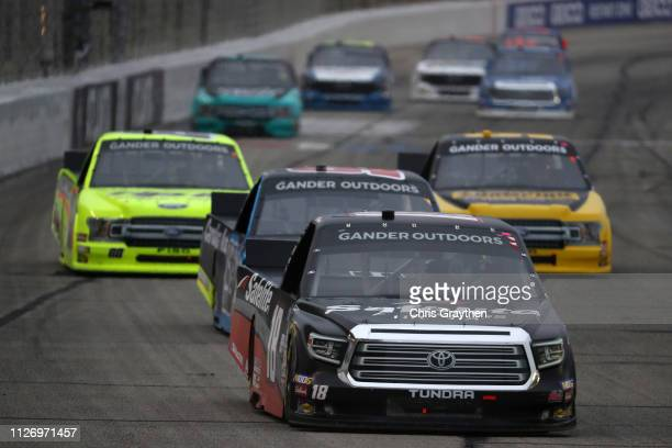 Harrison Burton driver of the Safelite AutoGlass Toyota leads a pack of cars during the NASCAR Gander Outdoors Truck Series Ultimate Tailgating 200...